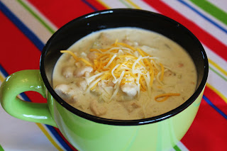 Creamy white Chicken Chili with Cheese in bowl