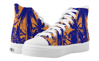 Shoes with pattern of palm trees in blue and orange