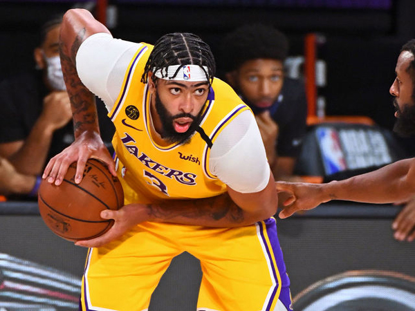 Anthony Davis will play with the Los Angeles Lakers for at least four more years.