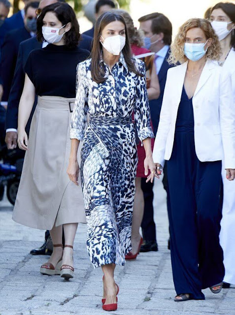 Queen Letizia wore a leopard print silk blouse and midi skirt from Victoria Beckham, and red leathe pumps from Carolina Herrera