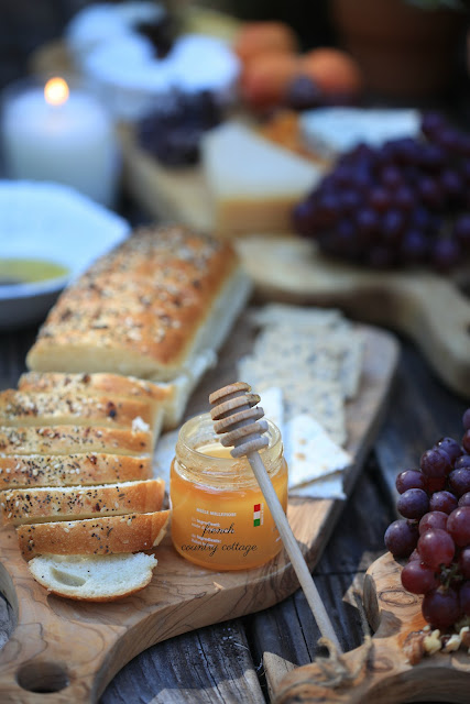 honey and bread on cheese board
