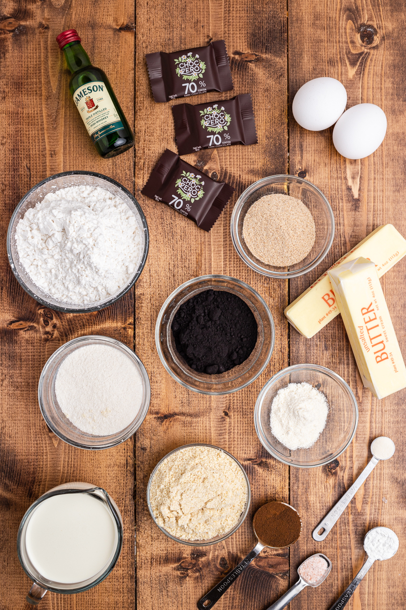Overhead photo of the ingredients needed to make Keto Irish Coffee Cupcakes on a wooden table.