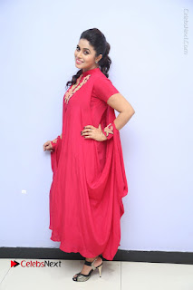 Actress Poorna Latest Stills in Red Dress at Rakshasi First Look Launch  0332.JPG