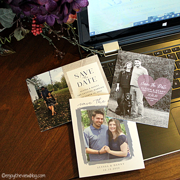 Three different Save-the-Date cards lying on an open laptop computer