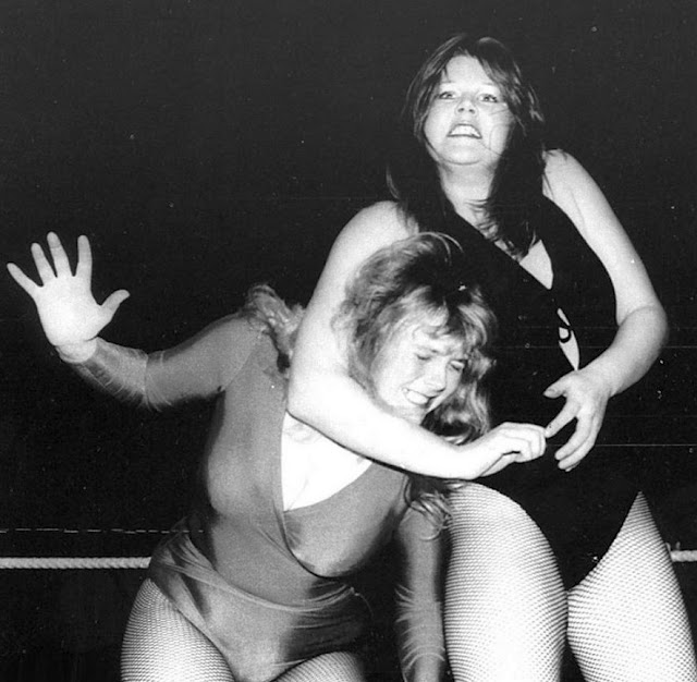 Mitzi Mueller and Rusty Blair wrestling