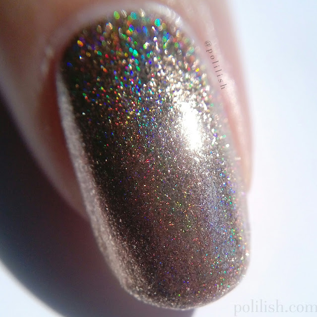 Macro swatch of Cirque Colors 'Cin Cin' (sunlight)