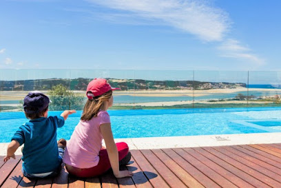 Heated pool overlooking Obidos lagoon and the sea behind