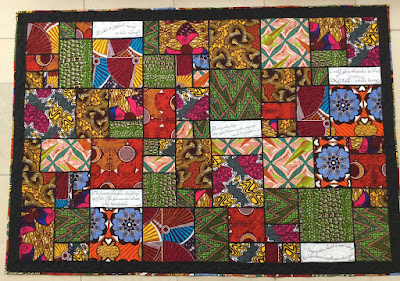 Quilt using African fabrics made by Catherine