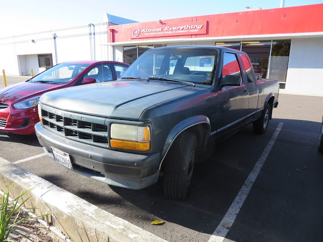 Very faded 1993 Dodge Dakota before complete paint job at Almost Everything Auto Body.