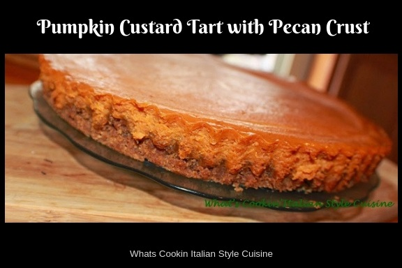 This recipe is how to make a pecan crusted pumpkin pie filled tart.this is a removable tart bottom pan with a pecan crust baked in it with a pumpkin custard pie filling. This pumpkin pie tart is creamy and decadent. The pan with the removable bottom makes it easy to take the pie out and stay firm. This pumpkin custard tart is made with just a few ingredients and easy to make