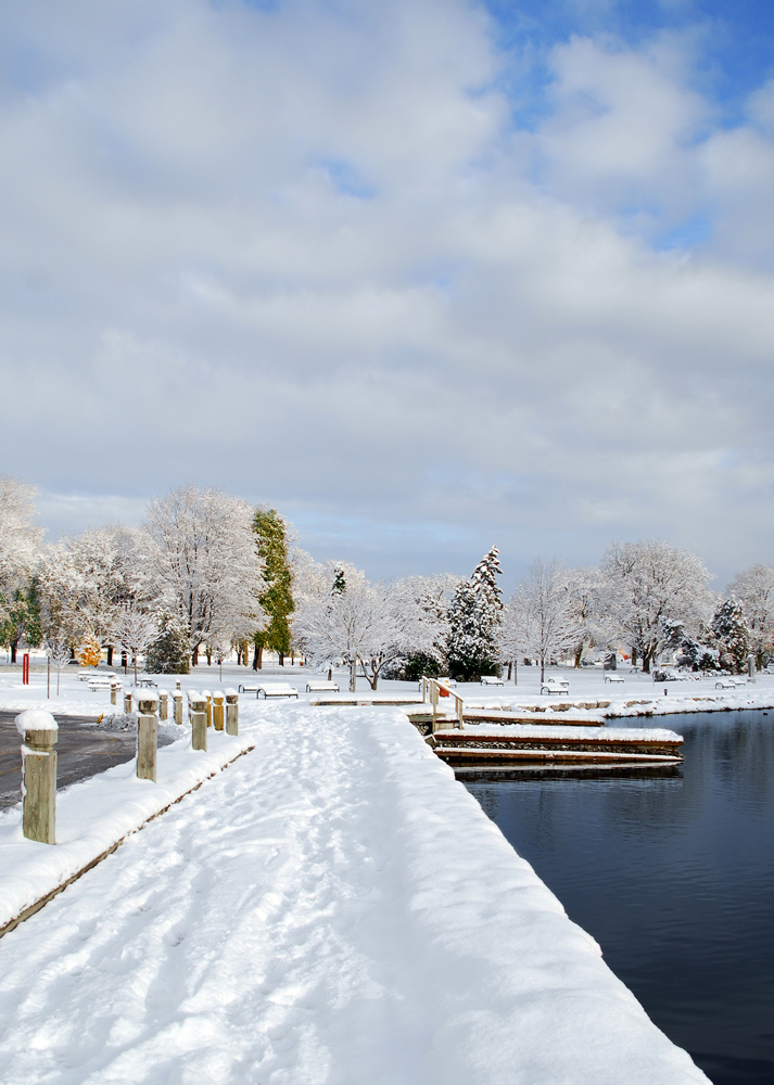 A local waterfront park after a winter snowfall.
