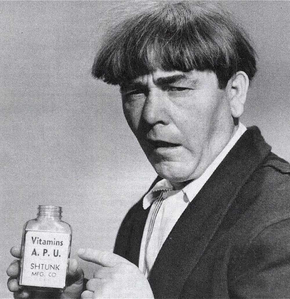 Moe Howard of the Three Stooges selling comedy vitamins