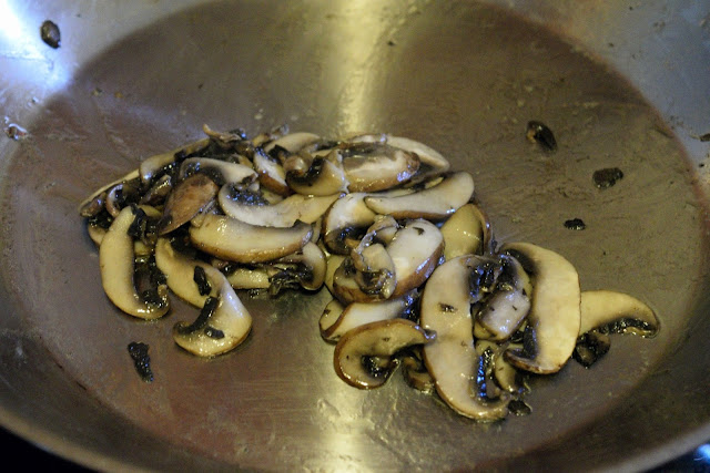 Fully cooked, sliced mushrooms, in the skillet.