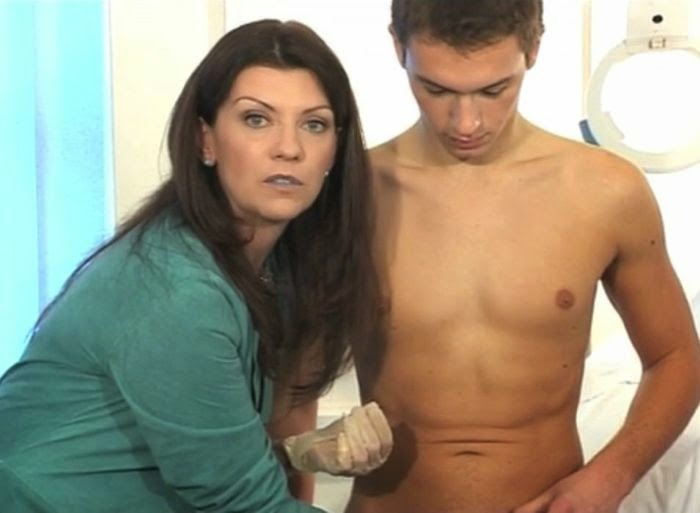 Female Doctor Giving Male Physical Exam