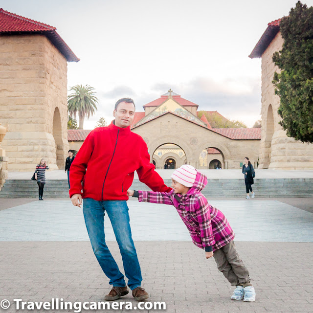 Many times you come across instances which offer great opportunities to click portraits which can become memorable for future. I clearly remember above photograph which was clicked at Stanford University in California. This photograph shows father-daughter duo. Father made some comment about his daughter's education in Stanford and daughter is pushing him to cover up her shyness about the comment in front of whole group of friends.     [Related to Camera] Experiment with different Perspectives and create something unusual :