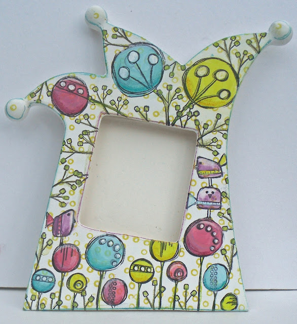 A beautiful stamped bisque frame from Helen Chilton