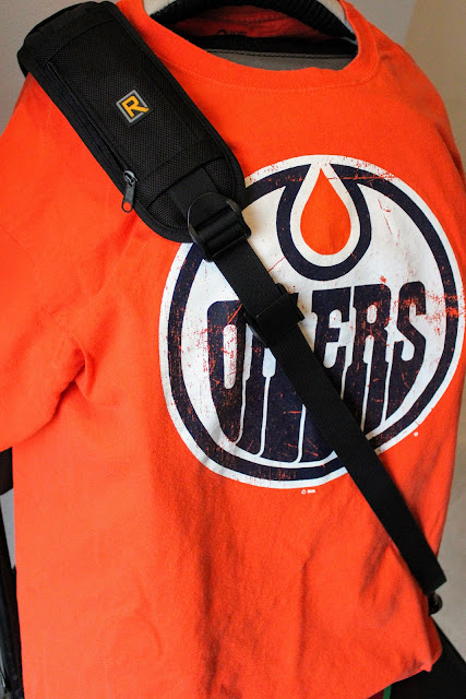 BlackRapid Camera Strap (RS-7). Strap on a Edmonton Oilers T-Shirt