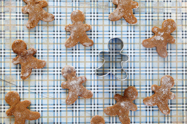 Homemade gingerbread dog treats with gingerbread person cookie cutter