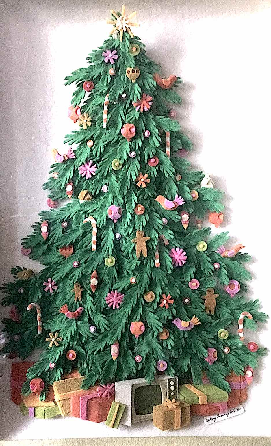 a Raymond Ameijide papercut children's illustration of a Christmas tree with gifts