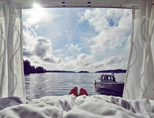 watching the sea from the bed in the van