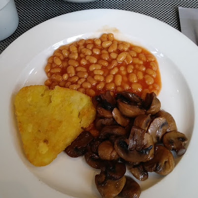 breakfast of fried potatoes, baked beans and mushrooms