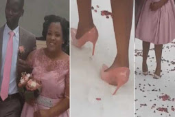 Watch As Bride Struggles To Walk on Heels Down The Aisle On Wedding Day