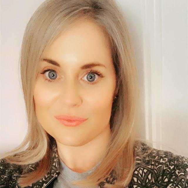 Blonde girl taking a selfie