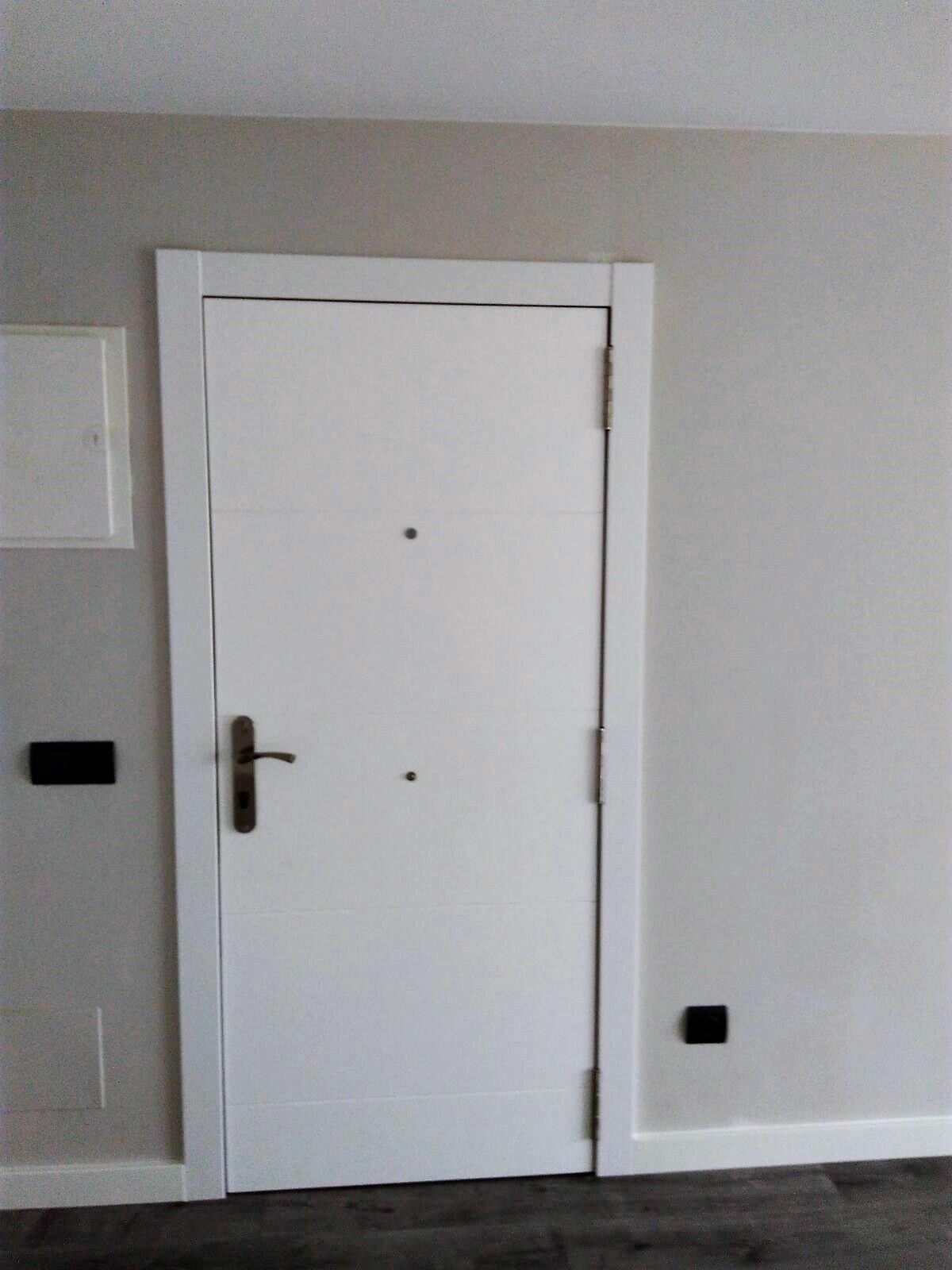 Rc fuster puertas en rub carpinter a puertas lacadas for Puertas y parquet
