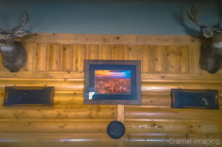 "Cramer Imaging's photograph of our ""Sunset at Bryce"" landscape photo framed and matted on display at Bryce Canyon Resort Restaurant"