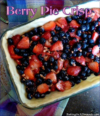 Berry Pie Crisp is a summertime favorite. An assortment of berries, mixed with a bit of toffee and baked as a pie, crisp hybrid. | Recipe developed by www.BakingInATornado.com | #recipe #pie