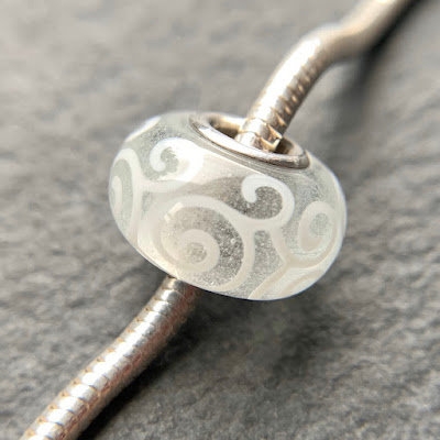 Handmade lampwork glass silver core big hole charm bead by Laura Sparling made with CiM Glow in the Dark