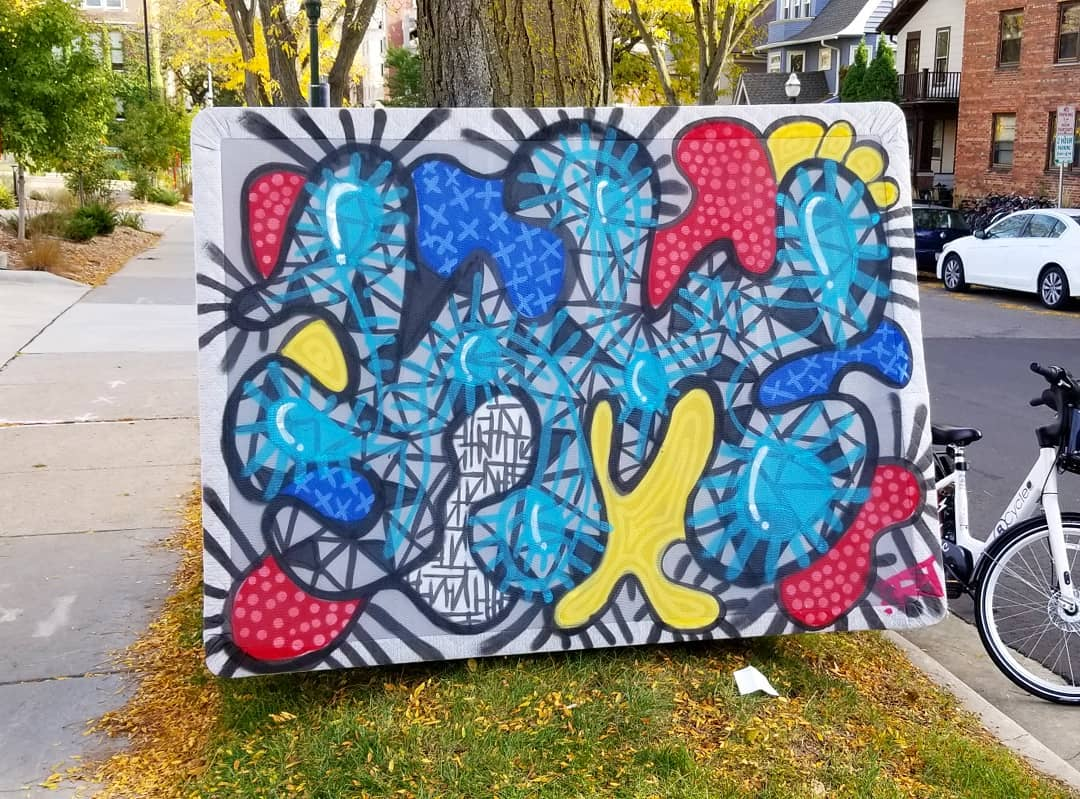 Image contains street art outdoors on mattress