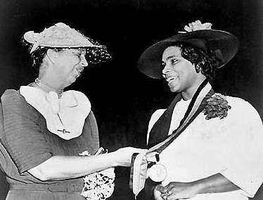 Eleanor Roosevelt (left) presents Marian Anderson (right) the NAACP 1939 Spingarn Medal Awarded each year for outstanding achievement by an African American.