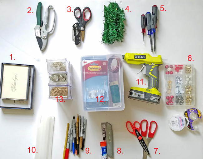 supplies like prunner, snip, utility knife, scissors, cards, screwdriver, tape, Ryobi hot glue gun in one bag for the holidays