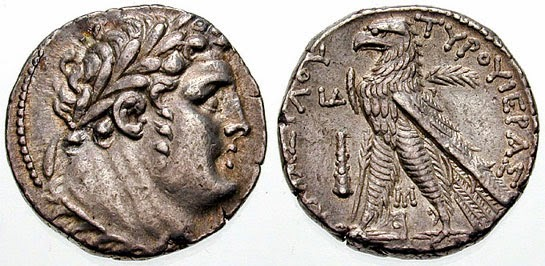 Coin of Tyre, depicting bust of Melqart, with lion skin tied around neck. On the other side is an eagle with palm branch on right wing and club to the left.