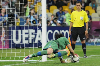 Buffon saves a penalty from England's Ashley Cole during Italy's quarter-final shoot-out win at Euro 2012