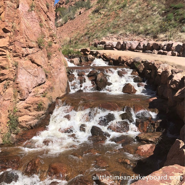 Rapids thunder over bronze boulders in Fountain Creek in Manitou Springs, Colorado