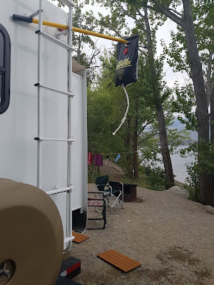 Solar shower in place on the rear ladder of our trailer.
