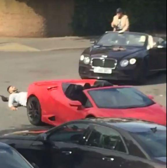 Watch this wannabe rapper fall off a moving Lamborghini during a music video shoot