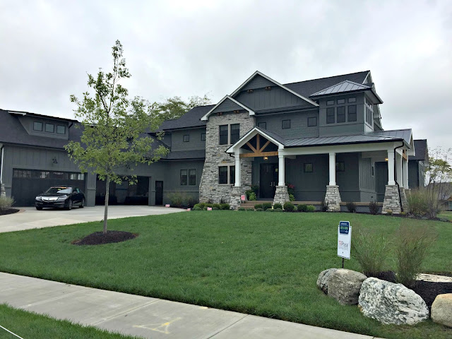 gray house with stone accents