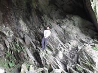 Nephew posing for camera inside Rydal cave- by: © Paul c Walton
