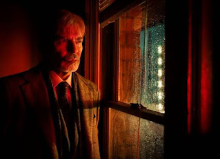 Billy Bob Thornton lit in red, with a beard