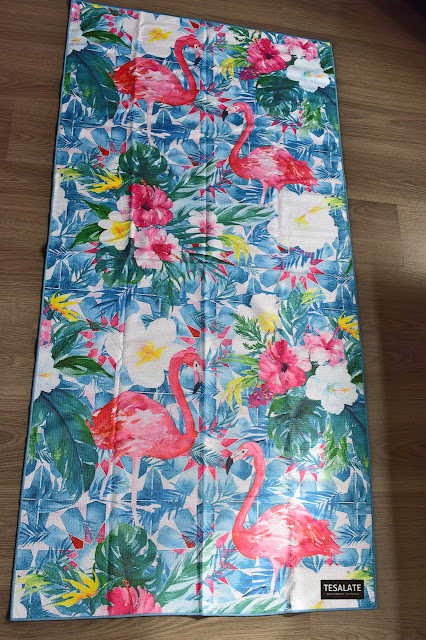 Tesalate towel - Paradise Found laid out on floor