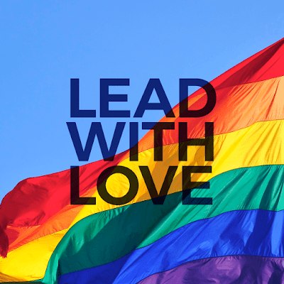 image of a colorful rainbow flag.  Text: Lead with Love