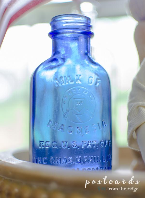 vintage blue milk of magnesia glass bottle