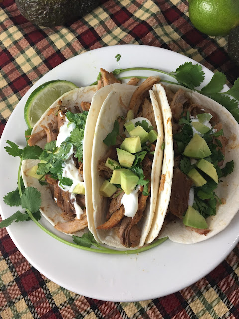 Chasing Saturdays, I love ordering carnitas at the restaurant and I knew I could make these at home! This easy, Crock Pot Pork Carnitas recipe, is so flavorful,  you will want to make it again!
