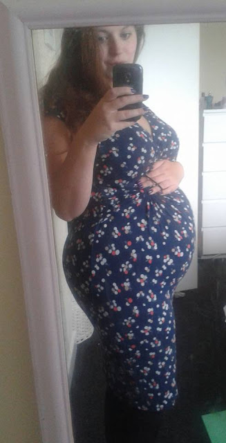 Eighteen weeks pregnant, bump shot
