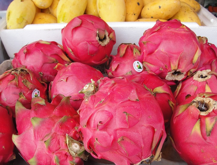 purple dragon fruits for sale at morning market in Penang Malaysia