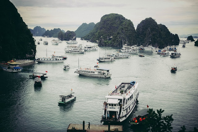 What should you visit when travelling in Halong Bay? 1