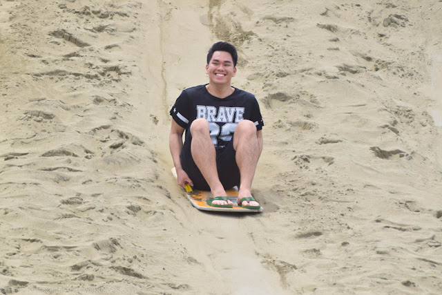 All smiles sliding down the La Paz Sand Dunes